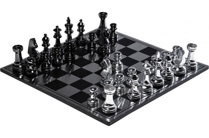 jeu d 39 chec 32 pi ces en acier chrom gadgets et jeux. Black Bedroom Furniture Sets. Home Design Ideas